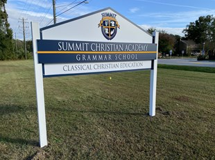 Post and panel sign for christian academy grammar school