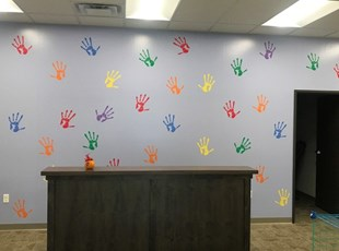Colorful Wall Graphic of Handprints