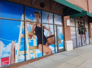 Perforated Window Film Graphic for European Wax Center with lady in swimsuit