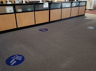Social DIstancing Floor Graphics in School Reception Area