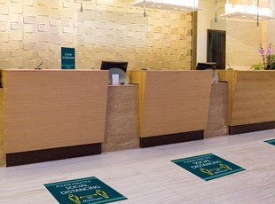 Social Distancing Floor Graphics Near Reception Desks