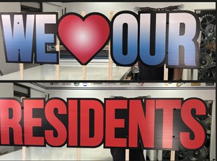 Routed Coroblast Signs for We Love Our Residents
