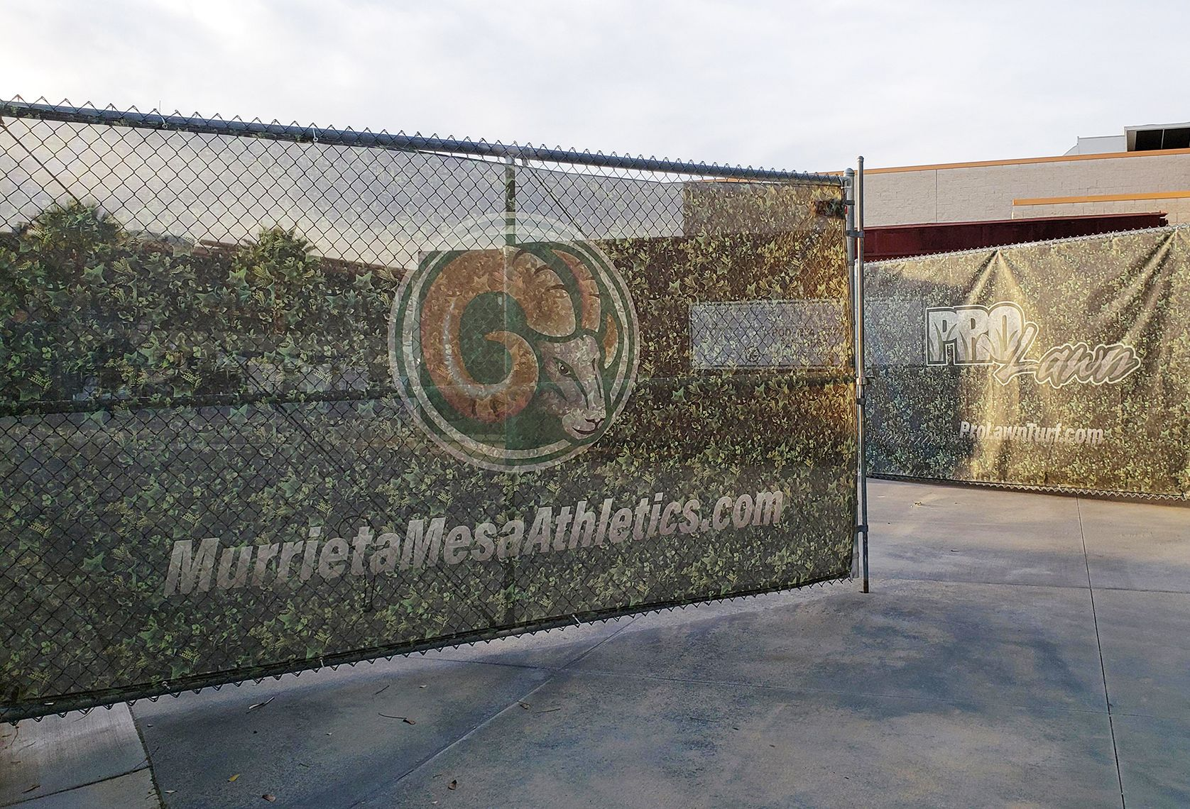 Outdoor mesh banner for athletics company
