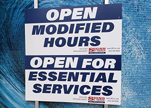 Open with Modified Hours COVID-19 sign
