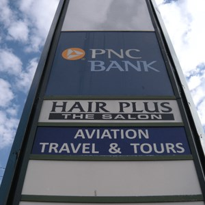 Pylon sign - Aviation Travel and Hair Plus