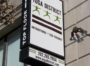 Lightbox Blade Sign for Yoga District in Washington, DC