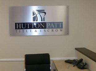 Silver Dibond Lobby Logo with Standoffs for Hutton Patt Title & Escrow