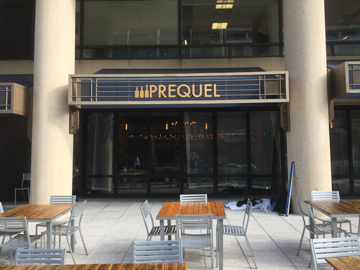 Gold Metal 3D letters installed on rails for Prequel in Washington, DC