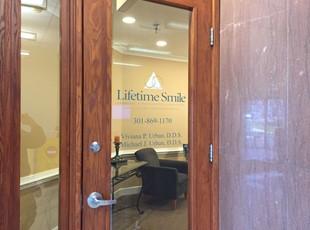 Vinyl Lettering on Glass door for Lifetime Smiles in Gaithersburg, MD