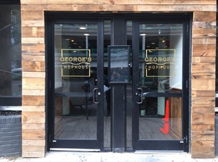 Gold vinyl logos on exterior doors for George's Chophouse in Bethesda, MD