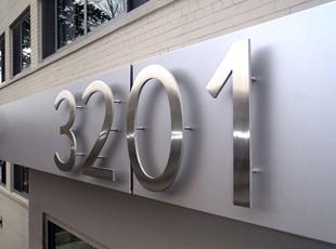 Brushed metal dimensional building numbers