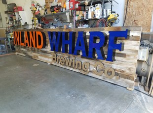 Inland Wharf Illuminated Channel Letters on Distressed Wood Backer