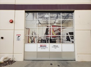 Perforated Window Graphics on Bay Door at Signs By Tomorrow's Murrieta installation facility