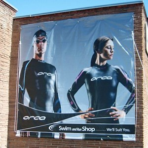A large format banner at the Swim and Run Shop in downtown Boise