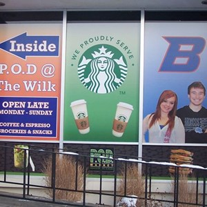 Full color vinyl window graphics promote services and provide directions as well