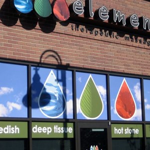 Full color vinyl covering the top windows make a pop of color on Elements storefront