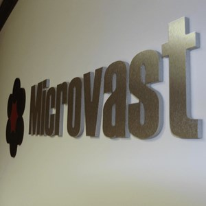 Black acrylic logo with text made from acrylic and brushed silver laminate