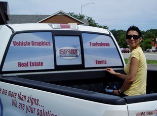 Vehicle Wrap with Perforated Vinyl for Rear Windows