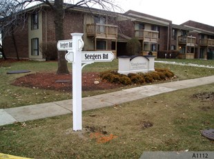 Foam Monument Sign (Background) and PVC Street Signs for Tanglewood Apartments in Arlington Heights