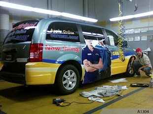 Final touches on vehicle wrap - CARMAX, Schaumburg, IL