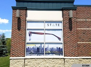 Perforated Window Film | Outdoor Vinyl Lettering & Graphics | Retail | Europa Eyewear, Vernon Hills, IL