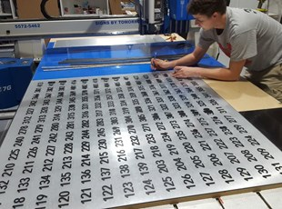 Using our AXYZ Trident to manufacture Room ID Signs