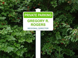 Outdoor parking sign with PVC post
