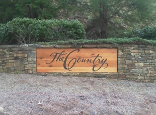 Outdoor routed wooden sign